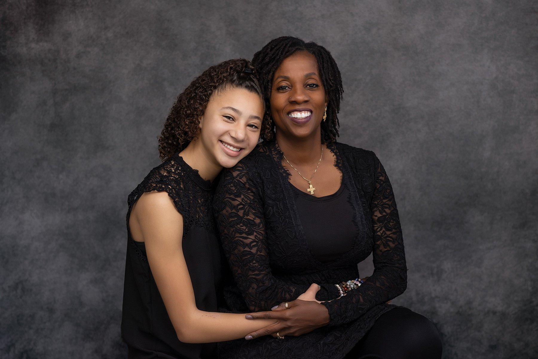 multi-family portrait session with grandmother and granddaughter