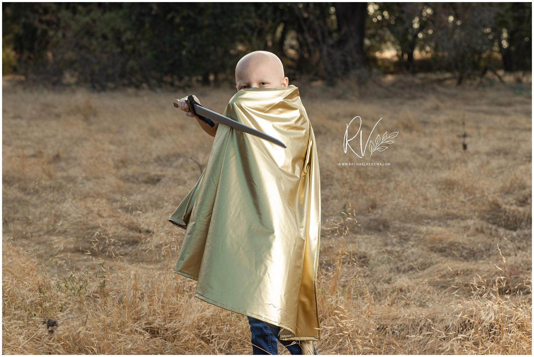 Family photographer Rachael Venema takes a family portrait for the Gold Hope Project