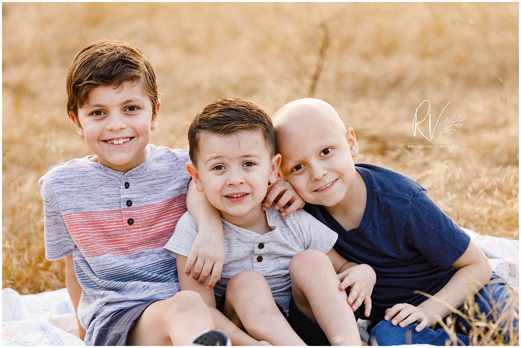 three boys posed outside Honda Hills near Ripon, CA