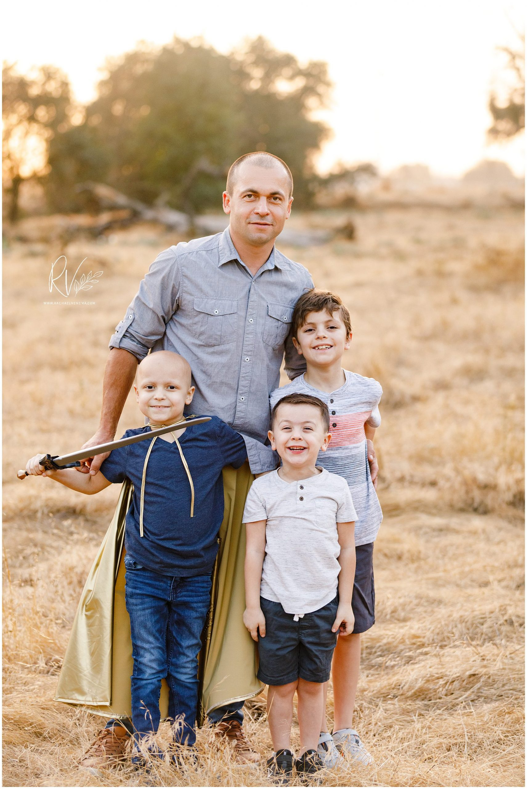 father with his sons during outdoor family portrait session